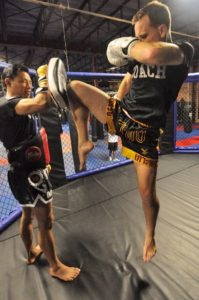 U.S. National Champion Muay Thai fighter Jeff Perry performing a flying Thai knee strike