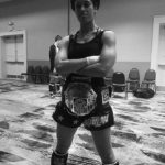 Brandon Richey Fitness strength student Victoria Debroux showing off her Women's IKF National title belt after training for weeks with my fitness programs