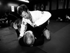 Guys Grappling In Jiu Jitsu practicing movement and submissions